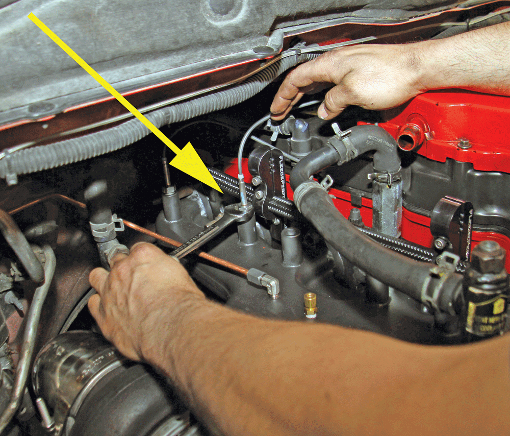 """8 Jake Richards installs the temperature sensors into the manifold making  sure to """"clock"""" the probe appropriately so that the exhaust pressure does  not run ..."""